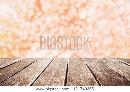 Wooden pier with orange blurred Bokeh, vintage tone