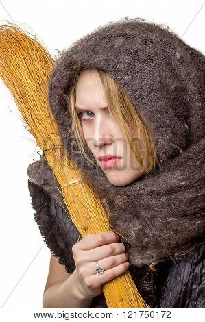 Angry Woman In A Scarf With A Broom In His Hand