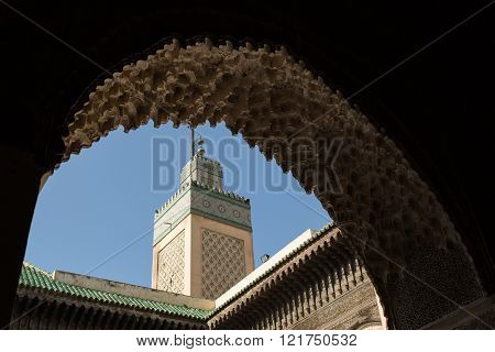 view of the minaret of the 14th century Bou Inania Medrese in the ancient medina of Fes, Morocco