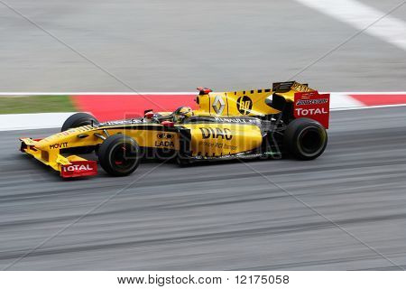 KUALA LUMPUR - APRIL 4: Renault F1 driver Robert Kubica powers down the track on race day at the 2010 Petronas Malaysia Grand-Prix on April 4, 2010 in Sepang International Circuit.