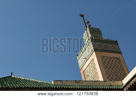 view of the minaret of the 14th century Bou Inania Medrese in the ancient medina of Fes, Morocco poster