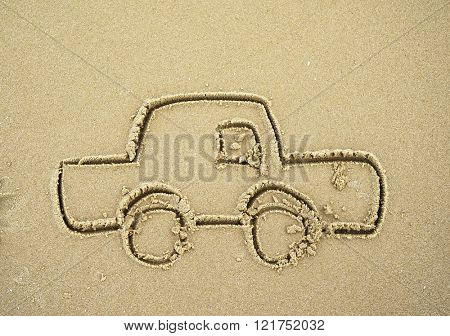 car drawing in the sand