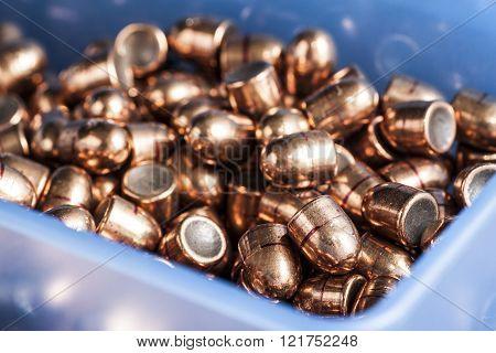Pistol bullets in a box