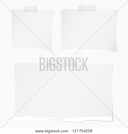 Pieces of torn white squared notebook paper with sticky tape on brown background