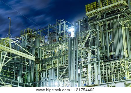 Oil and gas refinery industrial plant at night