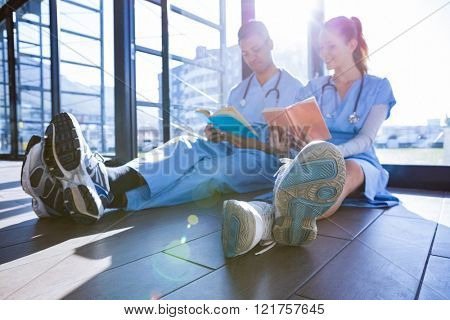 Medical team reading book at the hospital