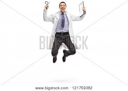Full length portrait of a young doctor jumping out of joy isolated on white background
