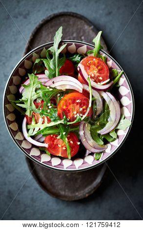 Cherry tomato and arugula salad with sesame seeds
