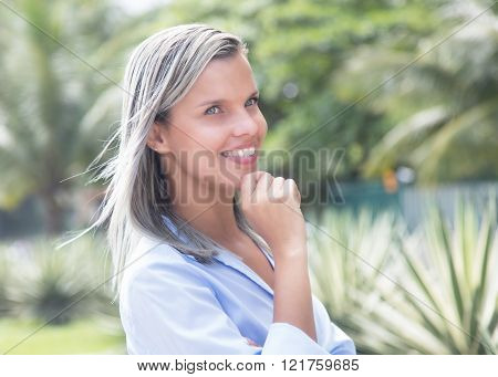 Beautiful Caucasian Woman With Blue Blouse In A Park