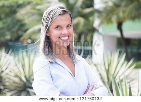 Happy Caucasian Woman With Blue Blouse In A Park