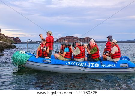 Galapagos, Ecuador - April 20: Unidentified People Photograph From Dinghy On April 20, 2015 Near Bar