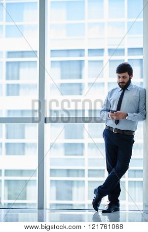 Businessman at big window