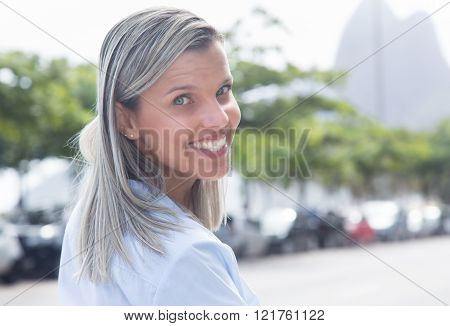 Caucasian Woman With Blue Blouse In The City Looking Around