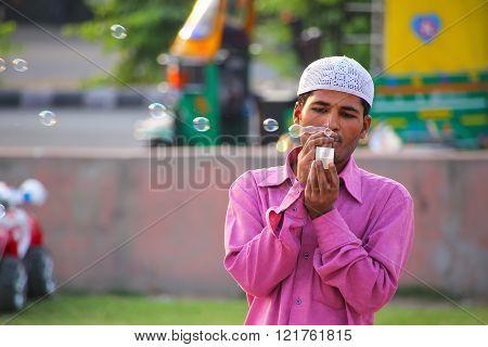 Jaipur, India - November 13: Unidentified Man Makes Soap Bubbles At Man Sagar Lake Waterfront On Nov