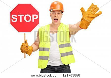 Construction worker holding a stop sign and gesturing with his hand isolated on white background