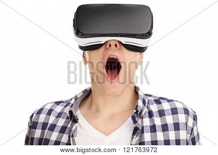 Close-up on an amazed young guy using a VR headset and experiencing virtual reality isolated on white background