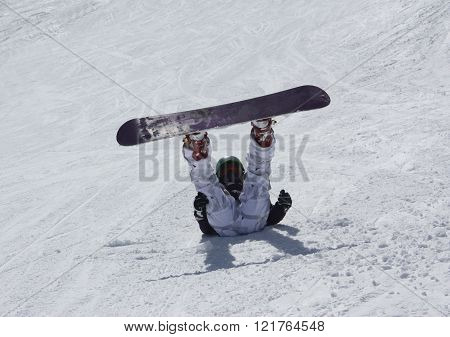 Young Snowboarder Woman Lie On The Ski Slope And Up Her Legs.