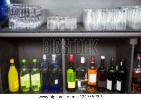 Alcohol bottles kept in a shelf in bar