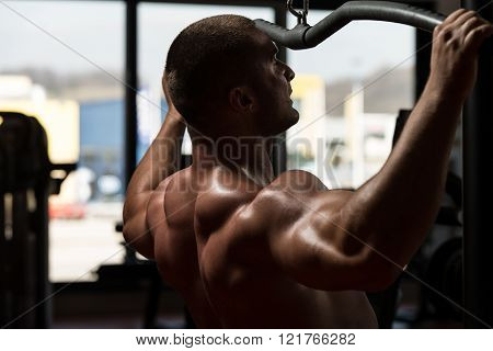 Man Doing Heavy Weight Exercise For Back