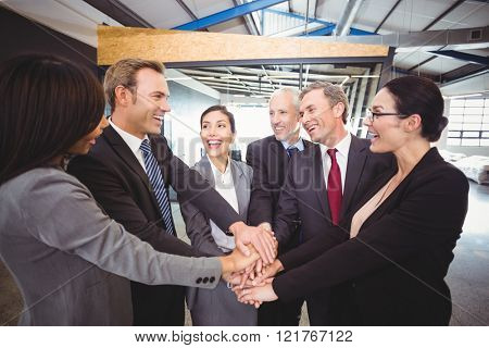 Businesspeople hands stacked over each other in office