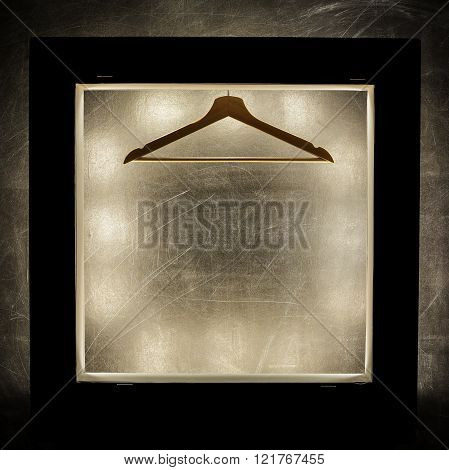 Wooden Hanger On Bright Background.