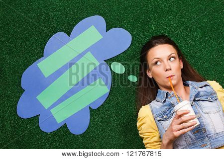 Woman drinking coffee and thinking