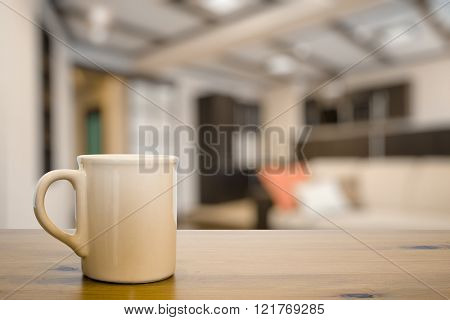 mug on old vintage wooden table in the living room