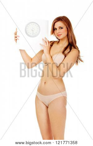 Slim woman holding a scale