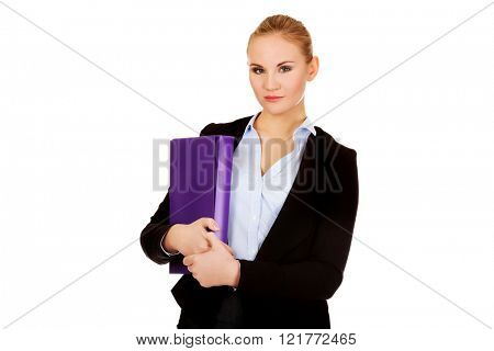 Smiling business woman holding a binder