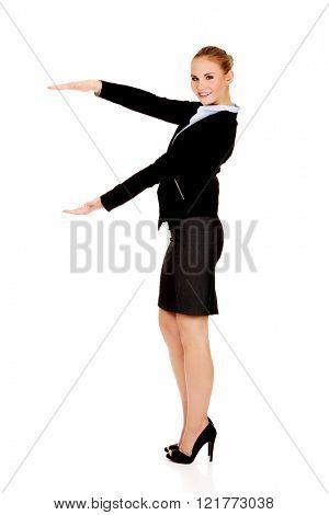 Business woman is having empty space between her hands