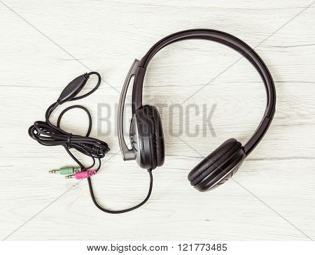 New Headset With Microphone On The Wooden Background