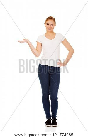 Young woman presenting something on open palm