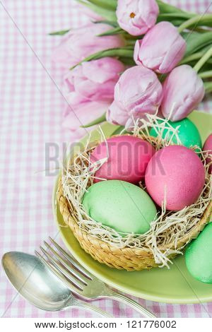 Basket With Flowers And Easter Eggs