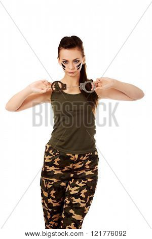 Serious woman soldier hold handcuffs