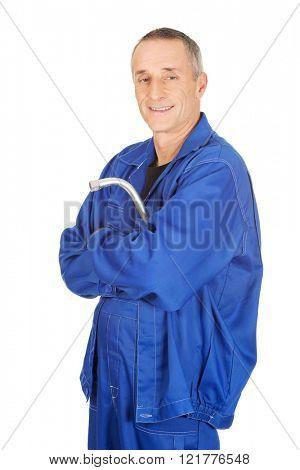 Happy repairman holding wrench