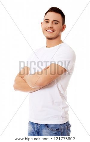 Young happy man with arms crossed