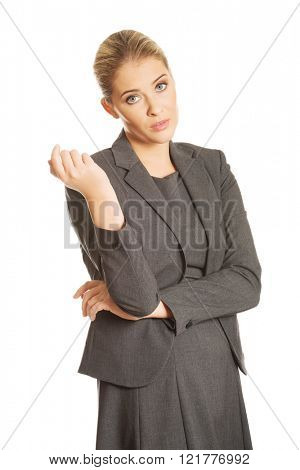 Confused woman showing irritate gesture