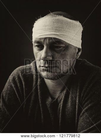 Head tied up by bandage. Black and white