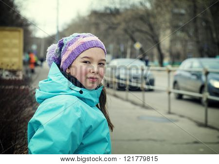 Beautiful girl waking in the street.