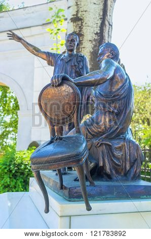 ODESSA, UKRAINE - MAY 18, 2015: The sculpture to the famous soveit writers Ilf and Petrov in the courtyard of the Odessa Literary Museum, on May 18 in Odessa.