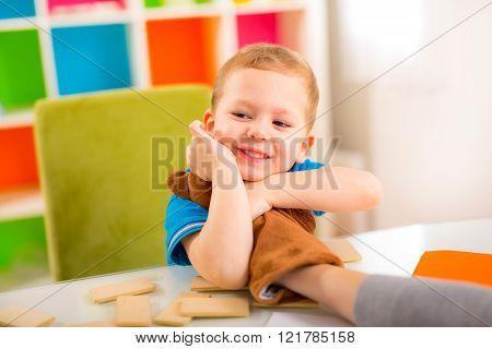Young Boy Hugging Teddy Bear