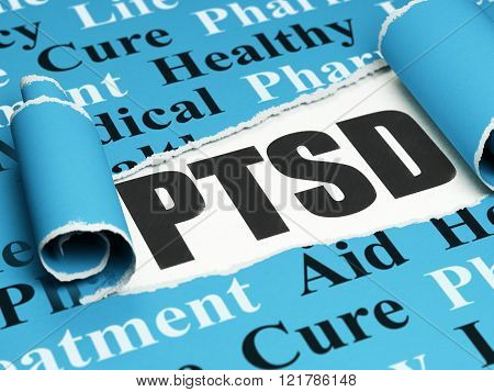 Healthcare concept: black text PTSD under the piece of  torn paper