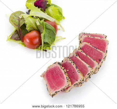 Tuna Filet With Sesame And Vegetables Over White Background