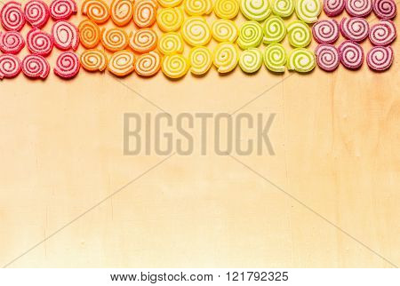 Candies And Jellies Colorful Sweets On Wood Background