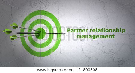 Business concept: target and Partner Relationship Management on wall background