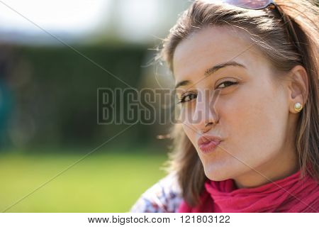 Beautiful Smiling Girl Sends You A Kiss
