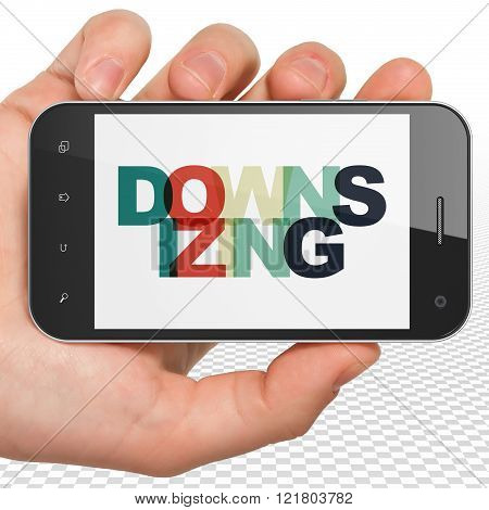 Finance concept: Hand Holding Smartphone with Downsizing on  display