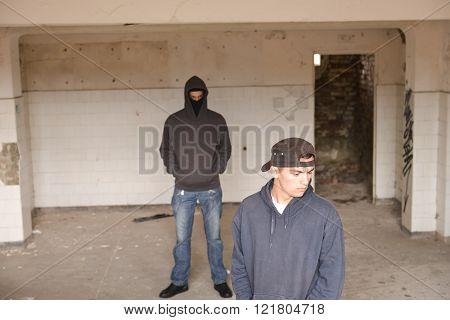 Two Street Hooligans Or Rappers Standing In A Old Abandoned Building