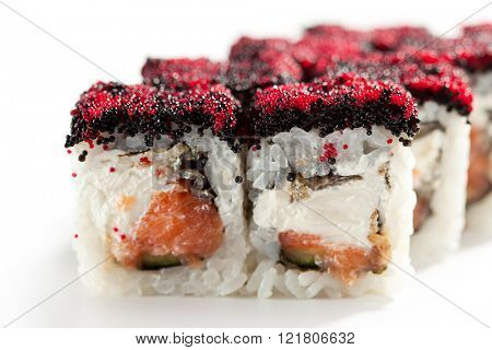 Maki Sushi - Sushi Roll with Fresh Salmon, Cucumber, Tamago and Cheese inside. Topped with Tobiko
