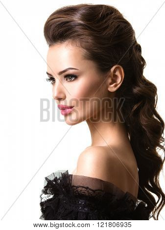 Beautiful face of an young sexy woman with long hairs posing at studio on white background